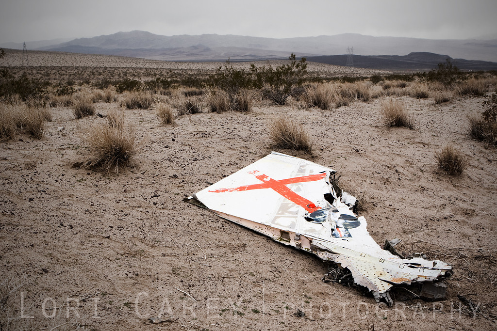 A piece of the wing at the F-4D Phantom crash site near the Cady Mountains in the Mojave desert. The Stars and Bars is cleanly visible at the lower right of the red X.