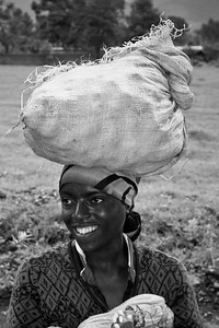 Woman Carrying child and potatos, Kinigi, Rwanda, Africa