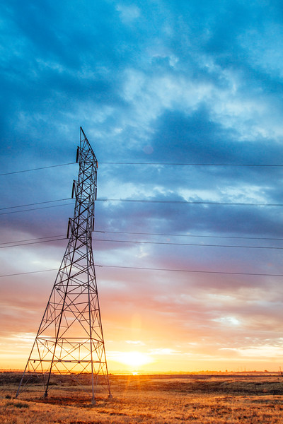 Power line transmission tower at sunrise