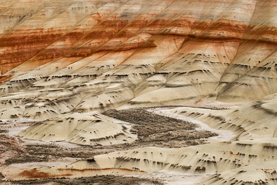 Surreal colored layers of sand of Painted Hills in Oregon