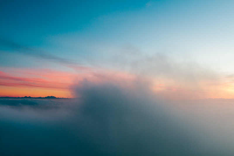 Aerial view of thick low clouds and mountains at sunrise
