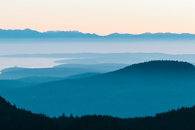 Layers of hills, mountains, islands and ocean at sunset in the Pacific Northwest