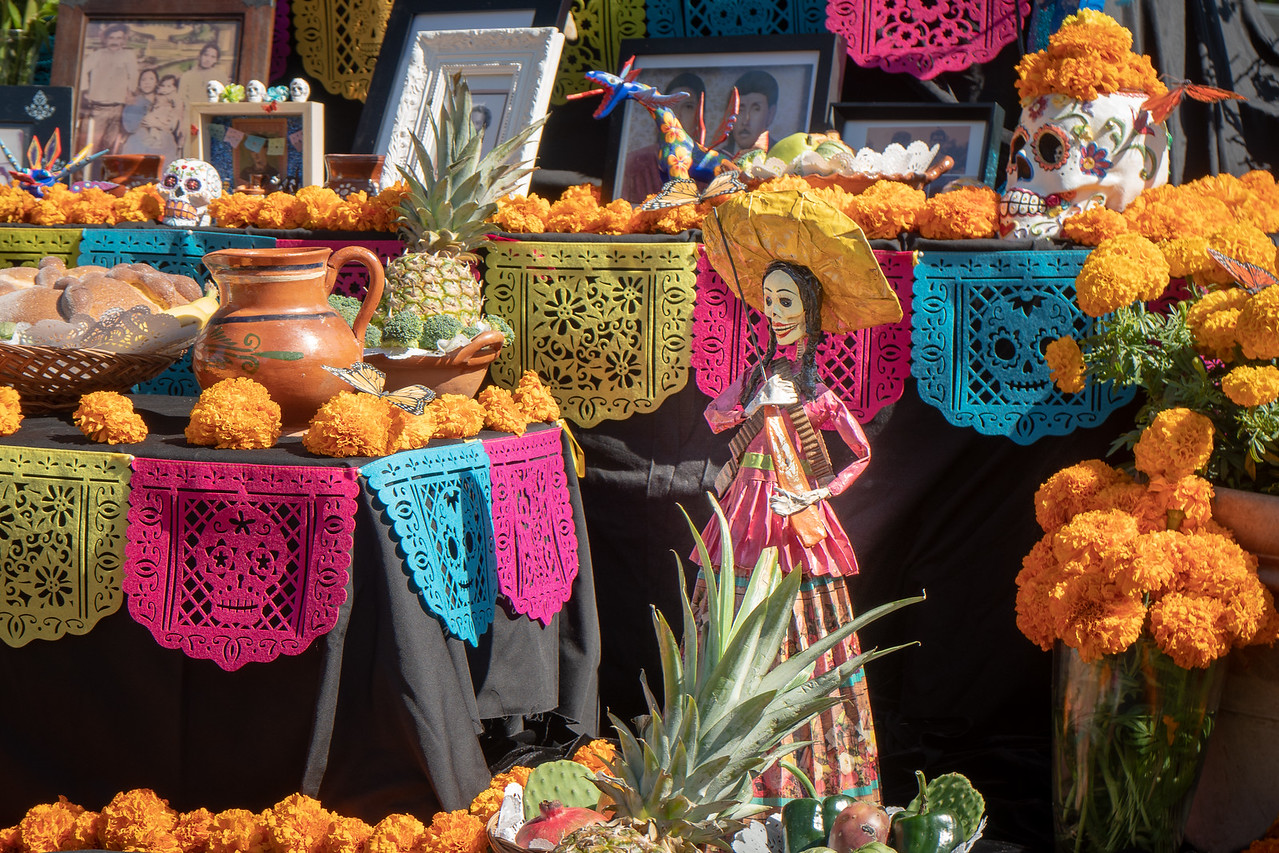 Orange marigolds decorate an altar at the Forever Cemetery