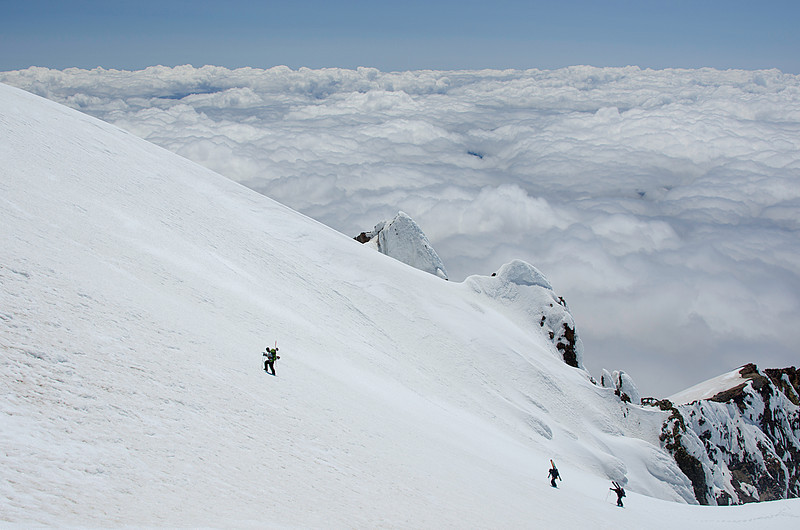 Skiers ascending Mt Hood near summit.