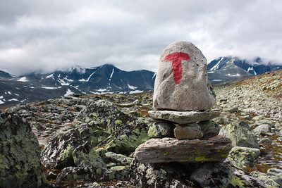 T-marked hiking trail on the Southern side of Snøhetta. The Norwegian Tourist Association (Den Norske Turistforening - DNT) maintains and extensive network of T-marked hiking trails in the Norwegian mountain areas.
