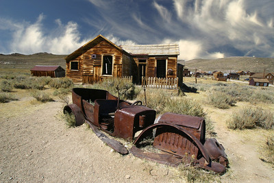 Decaying car and house in Bode Ghost Town, CA.
