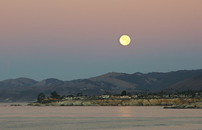 The full moon setting over Shell Beach, CA.