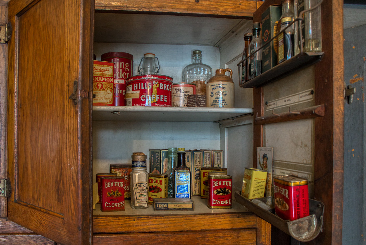 Kitchen cabinet filled with spices and extracts