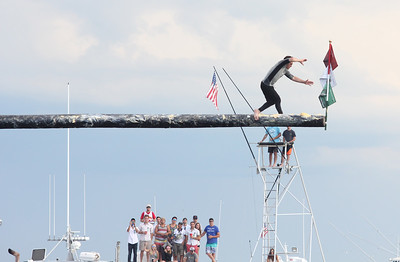 Jake Wagner wins Sunday's Greasy Pole during  90th annual  St. Peter's Fiesta.