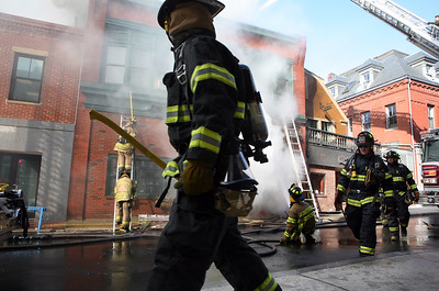 A three-alarm fire ravaged a historic downtown building in Gloucester early Friday morning.