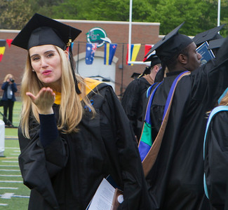 Photo by Amy Sweeney Taylor Fontneau blows a kiss to her family to thank them for their support as the Seventy-Eighth Commencement services begin at the Van Loan School at Endicott College held at Hemsptead Stadium on Thursday. May 17, 2018.