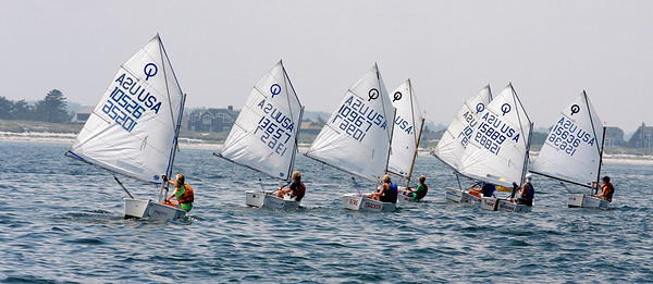 Gloucester:  The Optimist Pram racers sail against one another in the 107th Annual Squam Day, which took place at the Annisquam Yacht Club. Over six local yacht clubs participated in the event. Staff photo/Amy Sweeney Gloucester:  The Optimist Pram racers sail against one another in the 107th Annual Squam Day, which took place at the Annisquam Yacht Club. Over six local yacht clubs participated in the event. Staff photo/Amy Sweeney ORG XMIT: k4xxp177