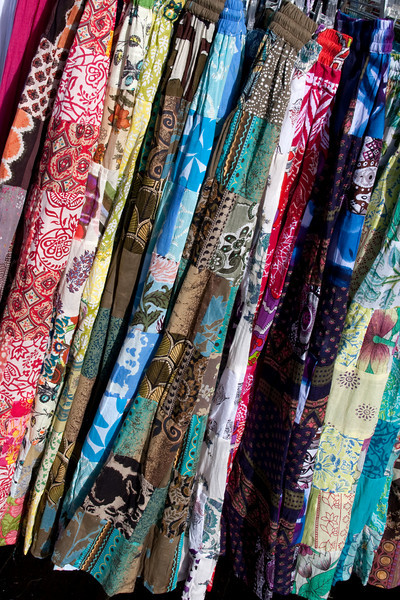 An entire rack of full, swooshy skirts, every one a different striking pattern and color.