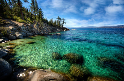 Tahoe CrinklesLake Tahoe, NV  Crinkley, green-blue, almost other-wordly gorgeousness. Lake Tahoe is just kinda All That.  A mile down in the deep parts... and brrr-cold most of the time!  Still, it's a mountain paradise that's second-to-none.