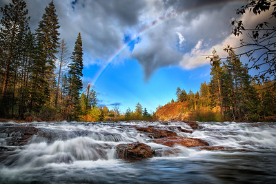 River of RainbowsYuba River, California  Any time you can snag a photo with a rainbow growing out of a river, best to take the opportunity. You just never know if there might actually BE a pot of gold waiting for you, right there. :D