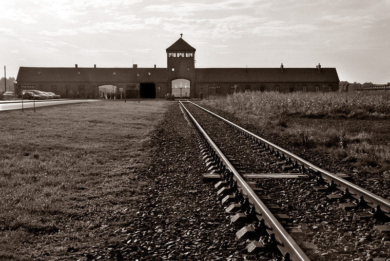 "Birkenau (known as Auschwitz II)--Main entrance gate, the infamous ""Death Gate,"" with guard tower"
