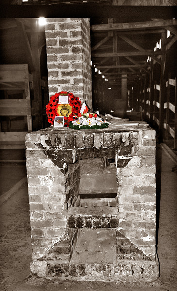Birkenau--Barracks with fireplace and chimney (providing a small amount of heat) and memorial placed by family of an inmate