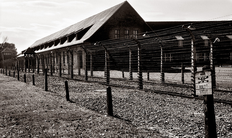 "Auschwitz--Barracks with ""HALT"" sign and electrified fencing"