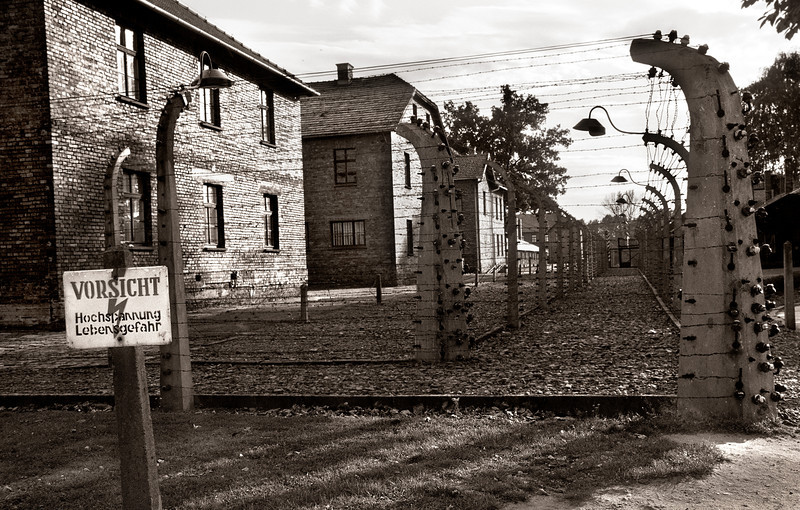 Auschwitz--View of barracks surrounded by double row of high voltage electrified fencing