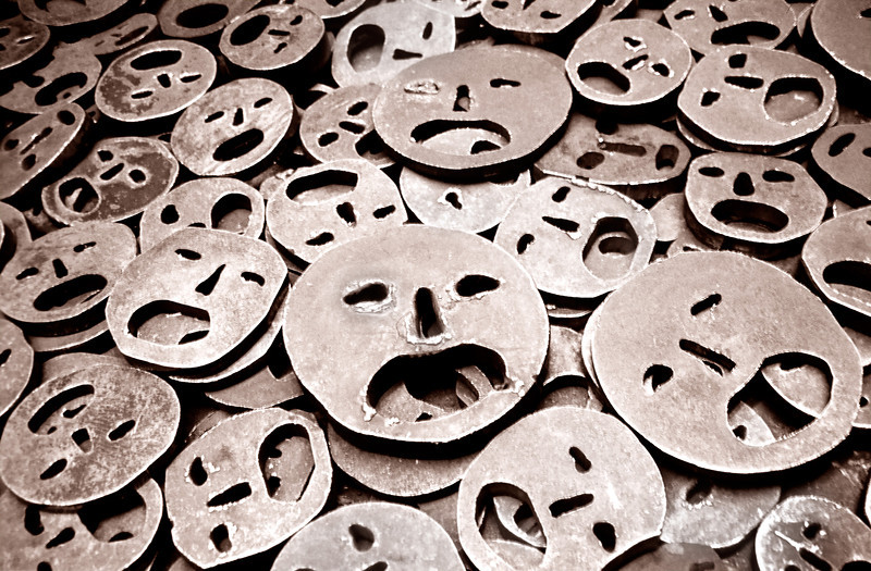 """Berlin--Jewish Museum, small portion of Menashe Kadishman's installation titled """"Fallen Leaves.""""  Over 10,000 open-mouthed iron faces cover the floor, in memory of the Holocaust as well as all victims of war and violence."""
