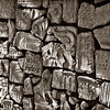 Krakow, Poland--Old Jewish Cemetery, portion of a memorial wall made of recovered pieces of gravestones shattered by the Nazis and used as pavement during the Polish occupation