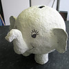 With hole cut for money nearly dry enough to paint.<br /> <br /> He is made using a balloon as the base .
