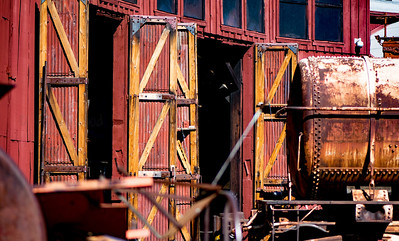 Red Roundhouse and Rusted Railcar