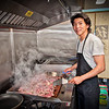 Eric Tsao making bulgogi in Korean food cart