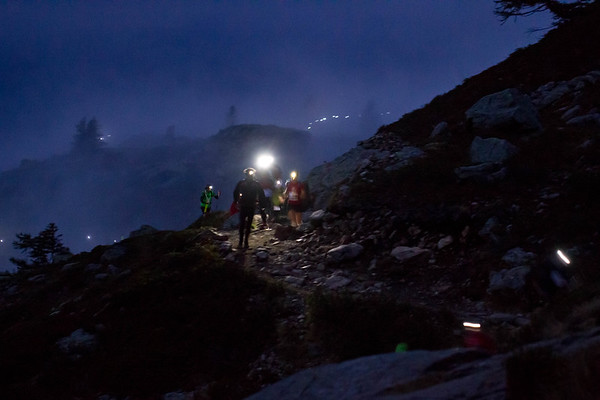 Mountain runners at night