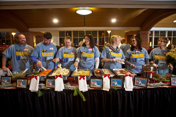 Left to right, stand Quinnipiac University volunteer staff and faculty, Brian Hurlbut, Chris Vendola, Bruce Saulnier, Anna Spragg, Joan Metzler, Mary Dunaway and Kathy Harris. They and others helped serve students during the Undergraduate Holiday Dinner which was held at Quinnipiac University's Carl Hansen Student Center on the Mount Carmel Campus, Thursday, December 4, 2014.