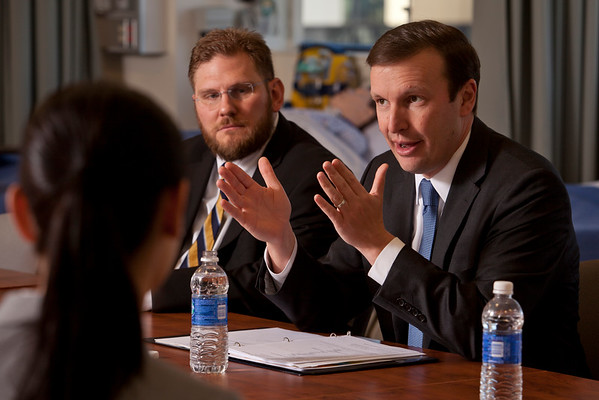 U.S. Sen. Christopher Murphy speaks with faculty and students of Quinnipiac's Nursing School on April 1, 2015 regard a recent JAMA study finding pay inequality between male and female nursing students. Nick Nicholson, left, Assisant Professor of Nursing, looks on as Sen. Murphy speaks.
