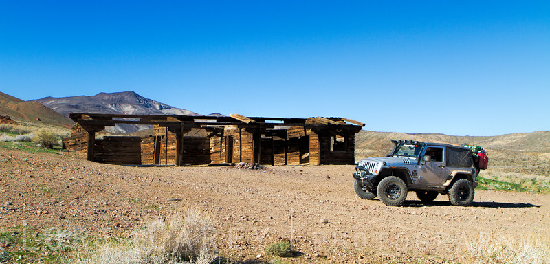 Jeep in front of the Holland Camp, the old camp for the Apache Mine in the El Paso Mountains, Mojave Desert, California