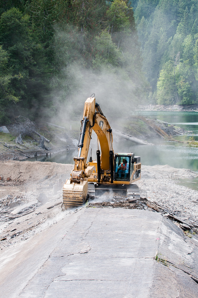 Gold painted bucket removes first scoops of Elwha Dam, September 17, 2011.