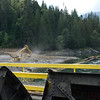 First Scoops of Cement Coming Out. September 17, 2011 Dam Deconstruction Day, Elwha Dam, Washington.