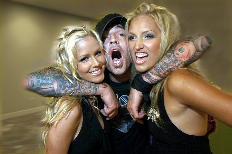 from left --Kristina Carrol of Canada, Tommy Lee, former drummer  and Malin Gudmundsson of Sweden  at the 22nd Miss Hawaiian Tropic International Pageant USA finals at the Turtle Bay Resort in Kahuku, Hawaii on the North Shore of Oahu,  Oct. 2, 2004.  Lee was one the judges of the over 100 young women competing to go on to to the final international  Miss Hawaiian Tropic competiton in Las Vegas in this spring.  The  competition is a beauty based event centering on bikini presentation and also personality.  Lee was hard at work all week at the 1st class oceanfront resort  picking the four finalist for the upcoming international contest.
