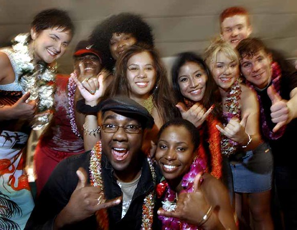 "The top ten 'American Idol' finalists, wearing fresh flowered leis give the Hawaiian shaka (or hang loose) sign after a press conference in Honolulu, Hawaii, Monday, September 27, 2004  From (l to r  front row ) George Huff, 22, of New Orleans, La Toya London, 25, of Oakland,  Ca. (Middle row , l to r, starting behind Huff) Camile Velasco, 19,  of Haiku, Maui,  Jasmine Trias, 17, of Mililani, Hawaii , Diana DeGarmo, 17, of Snellville, Ga. and Jon Peter Lewis, 24, of Rexburg Idaho. Top row (l to r) Amy Adams, 24,  of Bakersfield, Ca.,  Fantasia Barrino, 20, of High Point, NC,  Jennifer Hudson, 22, of Chicago and John Stevens, 17, of East Amherst, NY.  The group will be appearing in ""American Idols Live!"" Tuesday Sept. 28 through Thursday , Sept. 30th at the Blaisdell Arena in Honolulu. (AP Photo/Lucy Pemoni)"