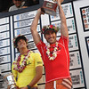 Joel Parkinson of Australia holds up the O'Neill World Cup of Surfing trophy with second place Jordy Smith (L) of South Africa in background  at Sunset Beach, Hawaii, Wednesday, Dec. 6, 2006.  Parkinson placed first in the second jewel of the Triple Crown of Surfing setting up a battle with former world champion Andy Irons for the Triple Crown title which will be deceided at the  Rip Curl Pro Pipeline Masters. The Pipeline Masters is the last event in the world surfing tour,  starting Friday at the infamous banzai pipeline on the North Shore of Oahu.  The triple crown title is the most prestigious surfing competition behind the world title already won by Kelly Slater. (AP Photo/Lucy Pemoni)