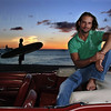 "Josh Holloway sits atop a vintage Mustang covertiable parked on Magic Island, in Honolulu, Hawaii, November, 5, 2005. Holloway maintains an easy-going and laid-back lifestyle in Hawaii apart from his growing status a star in ABC;s award-winning TV show ""LOST""."