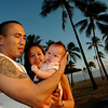 Jeremy Esmailka and his wife Deanza Hjalseth with their baby Sienna, on Waikiki beach in Honolulu, Hawaii, Dec. 20, 2007.  Hjalseth and Esmailka are amoung thousands who others make annual winter exodus from<br /> the 49th state to the 50th which is a predictable and attractive  business market. (AP Photo/Lucy Pemoni)