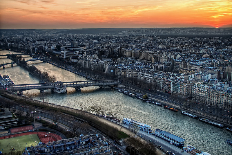 The view of the sunsetting from the top of the Eiffel Tower