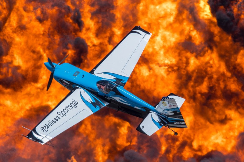 Mellissa Pemberton flies her Edge 540 near the fire explosion to excite the air show crowd during the Warriors Over the Wasatch program on Hill Air Force Base in Layton on June 26, 2016.