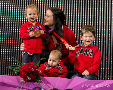 """SEGO2018-1203-017 3 December 2018  The International Olympic Committee and the Canadian Olympic Committee officially presented Christine Girard her London 2012 Olympic gold and Beijing 2008 Olympic bronze medals in weightlifting. The medal ceremony was held at the National Arts Centre in Ottawa, Ontario, Canada.   info from https://olympic.ca/press/christine-girard-awarded-london-2012-and-beijing-2008-medals/ :  """"Girard was initially awarded the bronze medal at London 2012. After the International Olympic Committee ordered retesting of more than 1500 urine samples from Beijing 2008 and London 2012, the samples from two athletes who placed ahead of her, Maiya Maneza of Kazakhstan and Svetlana Tsarukaeva of Russia, were found positive for doping. They were disqualified, losing their placings and medals. Girard was confirmed as the London 2012 Olympic champion in April 2018.  In late 2016, Girard was awarded the bronze medal from Beijing 2008 after Irina Nekrassova of Kazakhstan was stripped of her silver medal for testing positive for banned substances. Girard had initially placed fourth in the event.""""  © Serge Gouin 2018  www.segophoto.ca"""