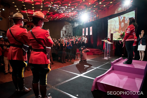 """SEGO2018-1203-013 3 December 2018  The International Olympic Committee and the Canadian Olympic Committee officially presented Christine Girard her London 2012 Olympic gold and Beijing 2008 Olympic bronze medals in weightlifting. The medal ceremony was held at the National Arts Centre in Ottawa, Ontario, Canada.   info from https://olympic.ca/press/christine-girard-awarded-london-2012-and-beijing-2008-medals/ :  """"Girard was initially awarded the bronze medal at London 2012. After the International Olympic Committee ordered retesting of more than 1500 urine samples from Beijing 2008 and London 2012, the samples from two athletes who placed ahead of her, Maiya Maneza of Kazakhstan and Svetlana Tsarukaeva of Russia, were found positive for doping. They were disqualified, losing their placings and medals. Girard was confirmed as the London 2012 Olympic champion in April 2018.  In late 2016, Girard was awarded the bronze medal from Beijing 2008 after Irina Nekrassova of Kazakhstan was stripped of her silver medal for testing positive for banned substances. Girard had initially placed fourth in the event.""""  © Serge Gouin 2018  www.segophoto.ca"""