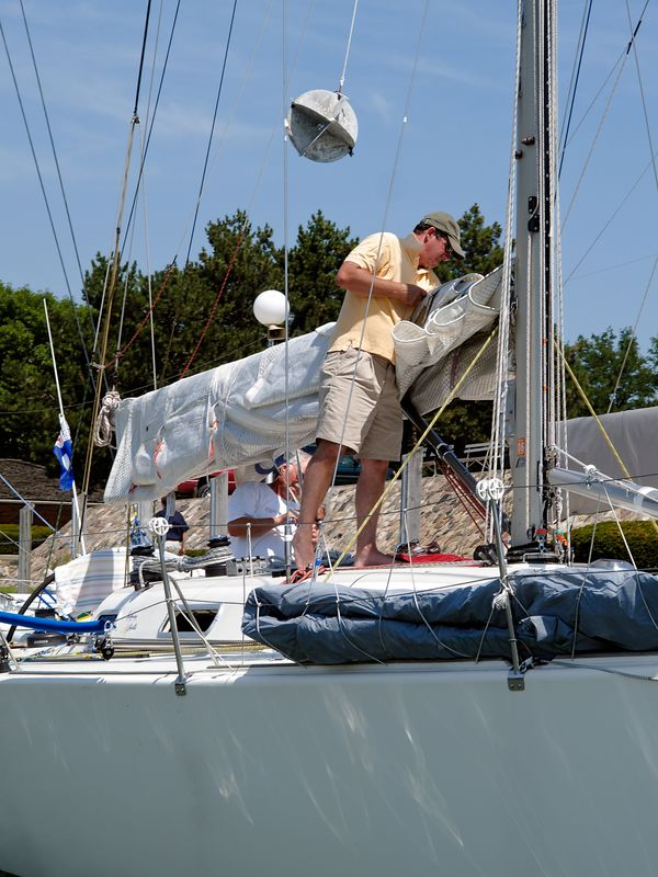 <font size=3>A crewmember works the main sail in preparation for Saturday's run.</font>