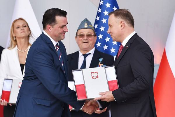New Britain Lawyer Adrian Baron received Polish Flag from Polish President