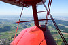 The Swiss landscape as seen through Rusalka's biplane wing.