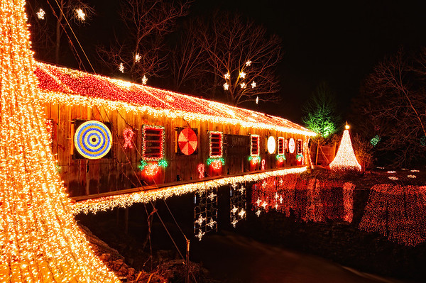 A Great place to take Christmas Light Photos is the Clifton Mill, they have a light show on this Covered Bridge to the music of the Trans Siberian Orchestra, the Mill area is decorated with over 10,000 lights.