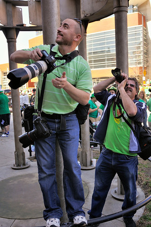 Dale and Nick photographing the rowdy people in the H. Black Company building. - Saint Patrick's Day Parade 2012