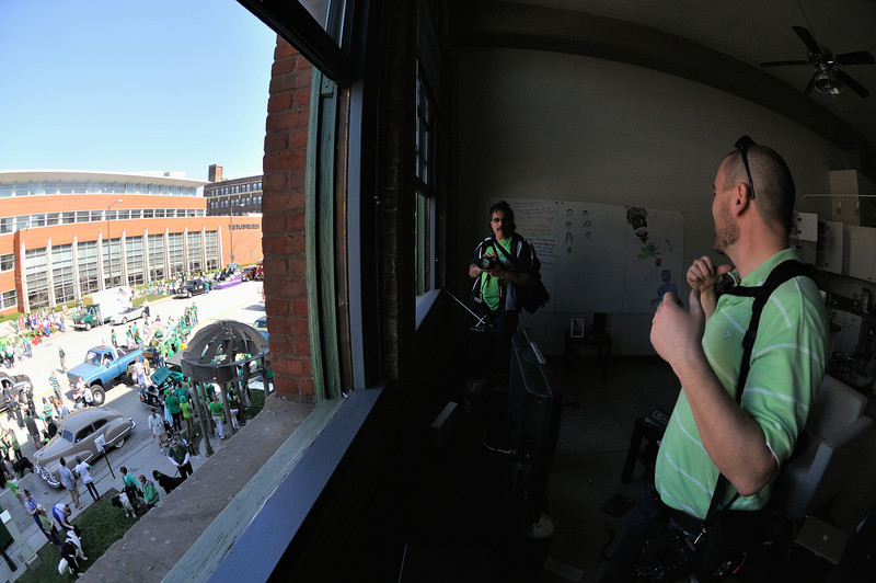 Checking out the view from an apartment above the parade route. - Saint Patrick's Day Parade 2012