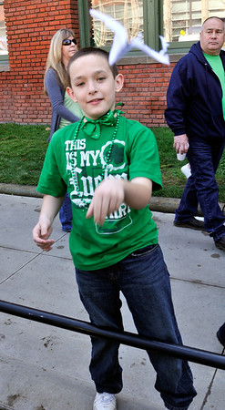 Little Kid throwing a paper airplane at me at the Saint Patrick's Day Parade 2012